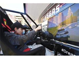 Ethan Chase of Las Vegas tries out a driving simulation