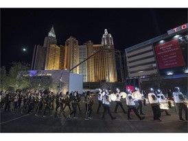 The Vegas Golden Knights drum line and cheerleaders march towards the stage