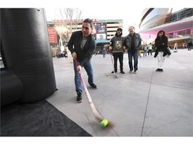 A hockey fan takes a shot in the Vegas Golden Knights booth
