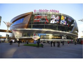 A banner ad on the side of T-Mobile Arena announces the Ultimate Vegas Sports Weekend pep rally