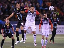 Las Vegas Lights Carlos Alvarez collides with D.C. United's Junior Moreno