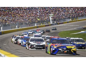 The field heads into turn one on a restart during the Monster Energy NASCAR Cup Series Pennzoil 400