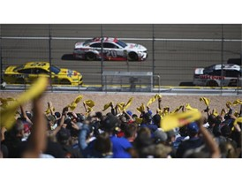 Fans wave Pennzoil flags during the Monster Energy NASCAR Cup Series Pennzoil 400