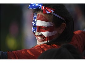 A fan with USA face paint smiles during the USA Sevens Rugby tournament