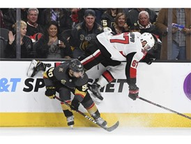 Ottawa Senators defenseman Ben Harpur (67) leaps over Vegas Golden Knights left wing Tomas Tatar (90)