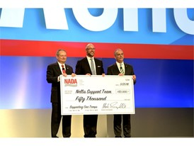 The National Automobile Dealers Association (NADA) donates $50,000 to the Nellis Support Team