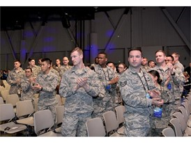 Airmen and women as the National Automobile Dealers Association donates $50,000 to the Nellis Support Team