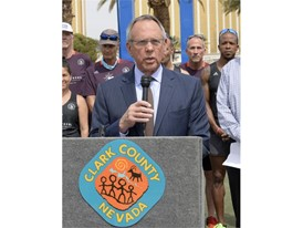 Clark County Commissioner Jim Gibson thanks the Vegas Strong Resiliency Center's Boston Marathon Team