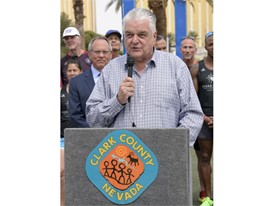 Clark County Commissioner Steve Sisolak thanks the Vegas Strong Resiliency Center's Boston Marathon Team