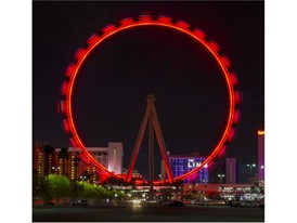 The High Roller at the Linq Promenade turns red for National Travel & Tourism Week
