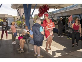 Las Vegas showgirl Porsha Revesz greets riders at the Bonneville RTC Transit Stations
