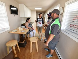 Elizabeth Malzewski describes the features of an Operation Tiny Home unit