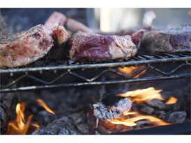Ribeyes are cooked over charcoal during the Grand Tasting