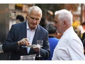 Caesars Palace President Gary Selesner samples food from chef Guy Savoy during the Grand Tasting