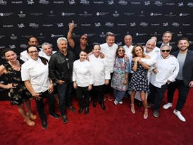 Chefs pose on the red carpet during the Grand Tasting