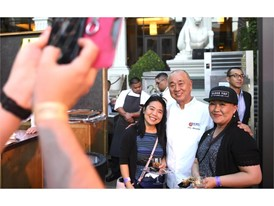 Nobu Matsuhisa poses with fans during the Grand Tasting