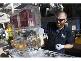 An ice sculpture gets finishing touches during the Grand Tasting