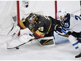 Vegas Golden Knights goaltender Marc-Andre Fleury stops a shot by Winnipeg Jets
