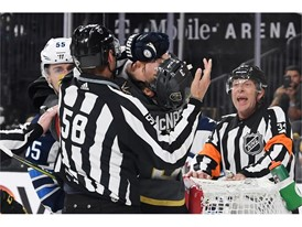 Winnipeg Jets center Mark Scheifele gets his glove in the face of Vegas Golden Knights defenseman Brayden McNabb