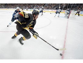 Vegas Golden Knights left wing Erik Haula is chased by Winnipeg Jets