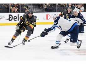 Vegas Golden Knights right wing Alex Tuch gets a pass by Winnipeg Jets defenseman