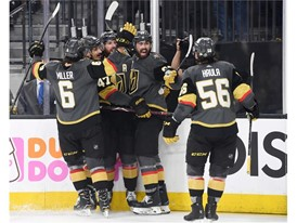 Vegas Golden Knights players celebrate James Neal's goal against the Winnipeg Jets