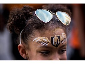 Tenlee Jenkins, 6, has her face painted before the start of Game 6