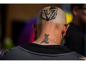A fan with the Vegas Golden Knights logo spray painted on his head