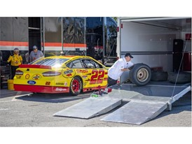 Mechanics change the tires on Joey Logano's No. 22 Team Penske Ford in preparation for the 2018 NASCAR Burnout Blvd