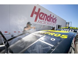Kenny Babbert of Hendrick Motorsports is engulfed in a cloud of polish as he prepares Jimmie Johnson's No. 48 Chevy