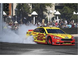 Joey Logano creates a plume of smoke during the 2018 NASCAR Burnout Blvd