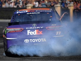 Denny Hamlin (11) throws smoke and rubber during the 2018 NASCAR Burnout Blvd