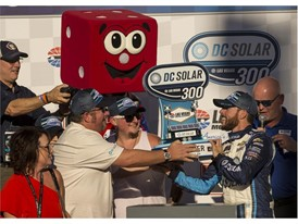 Ross Chastain #42, right, is awarded a trophy after winning the NASCAR Xfinity Series DC Solar 300