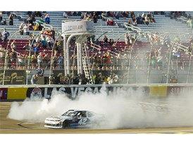 Ross Chastain #42 does a burnout at the finish line after winning the NASCAR Xfinity Series DC Solar 300