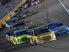 Eventual winner Grant Enfinger (98) leads the field on a restart during the NASCAR Camping World Truck Series World of W