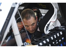 Johnny Sauter (21) Allegiant Chevrolet Silverado puts in his ear piece