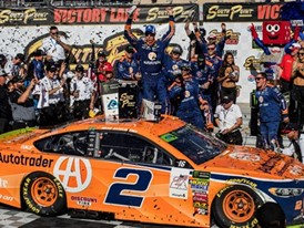 Brad Keselowski celebrates on Victory Lane after winning the NASCAR South Point 400
