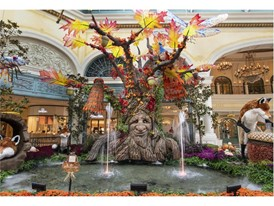 A colorful peacock in the branches of a talking tree are part of the autumn display at the Bellagio