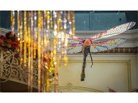 Dragonflies and LED-let hanging elements hover above the autumn display
