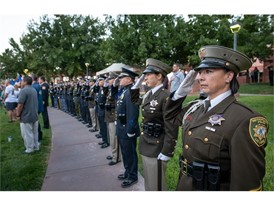 Officers of the multi-agency honor guard salute the opening of the 1 October Sunrise Remembrance