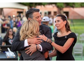 Mynda Smith is comforted by Nevada Governor Brian Sandoval and First Lady Lauralyn McCarthy