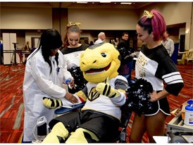 Chance the Vegas Golden Knight's mascot takes a seat in the donation chair
