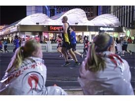 Two finishers watch race