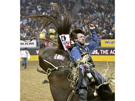 Tilden Hooper competes in bareback riding