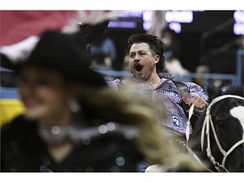 Wyatt Denny celebrates his first place finish in bareback riding