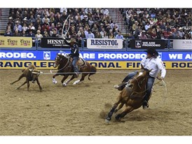 Erich Rogers and Clint Summers compete in team roping