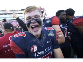 Fresno State quarterback Steven Comstock celebrates