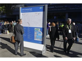 An attendee checks a map