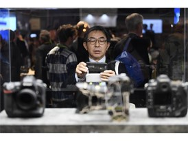 An attendee takes photos of Nikon cameras