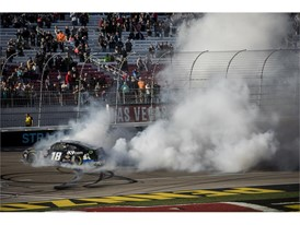 Kyle Busch performs a burnout